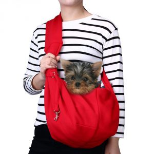 Small dog carriers like this red dog sling help you take your dog anywhere.